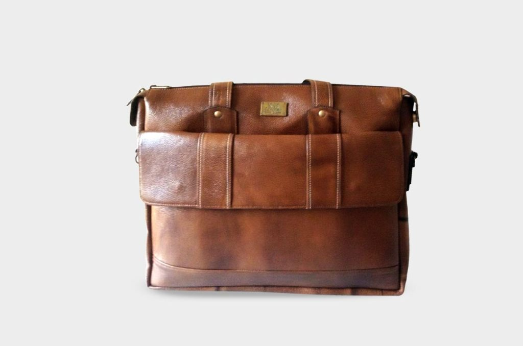 We supply customized leather products like valets, passport holders, laptop  bags, travel bags etc. These are made to order and comes in your design and  logo ...